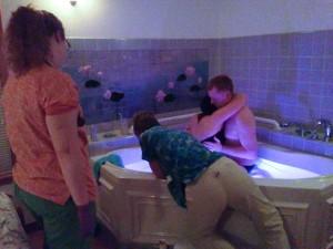 Kaye at the tub with Madi watching on